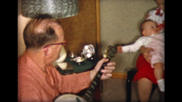1957 family plays banjo and piano - arts culture and entertainment stock videos & royalty-free footage