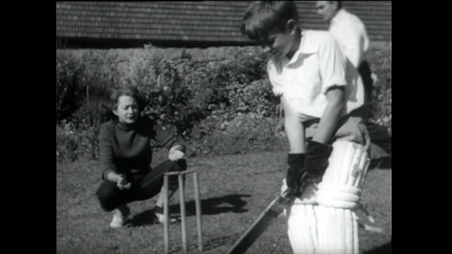 family plays cricket outdoors in the summer; 1955 - 1955 stock videos & royalty-free footage