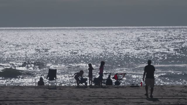 family plays in the ocean on september 25, 2021 on assateague island, maryland. there have been 10,166 deaths from covid-19 in maryland. - atmosphere filter stock videos & royalty-free footage