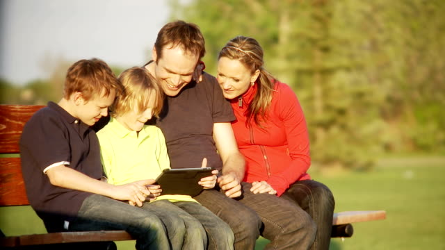 Family plays on a tablet together