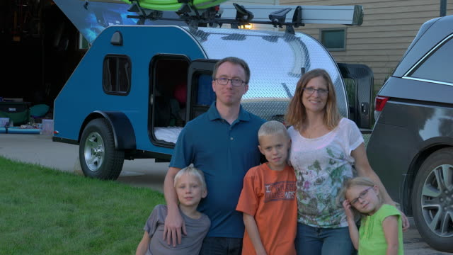 Family portrait in front of camper