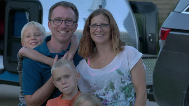 family portrait cu in front of mini camper - neenah stock videos & royalty-free footage