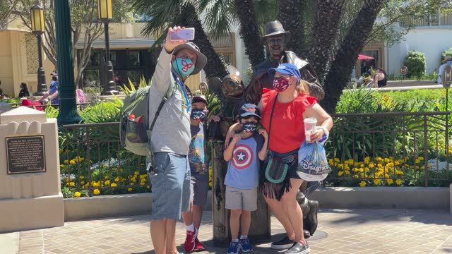 family poses as disneyland and disney's california adventure reopen with social distancing and a reduced crowd at the disneyland resort on april 30,... - adventure stock videos & royalty-free footage