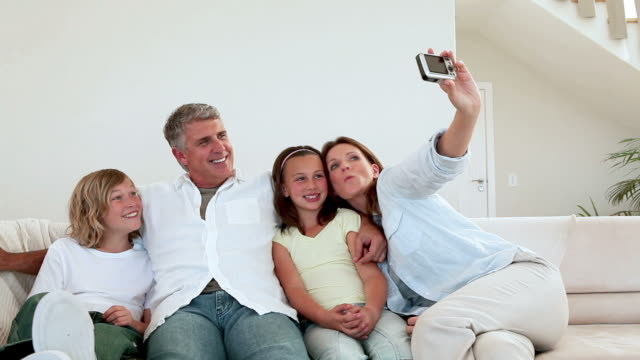 family posing for a photo - digital camera stock videos & royalty-free footage