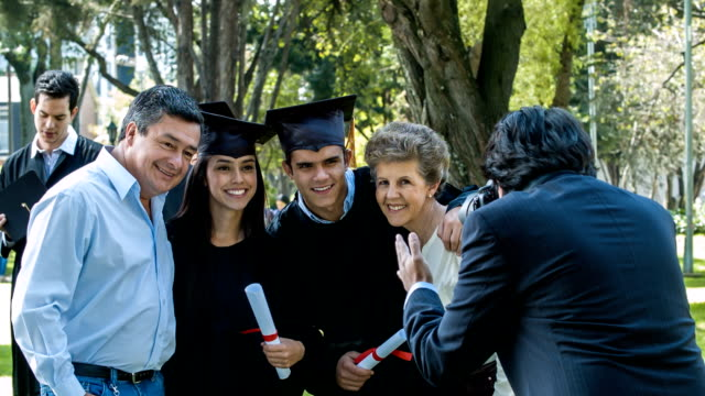 Family posing fot a picture on graduation day