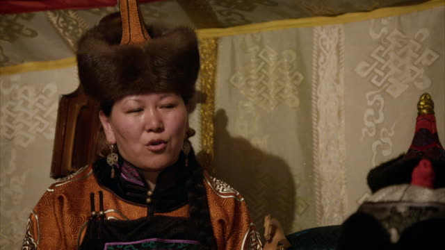 a family practices traditional tuvan throat singing (khoomei) together. - two generation family stock videos & royalty-free footage