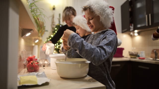 family preparing and baking christmas cakes - imgorthand stock videos & royalty-free footage