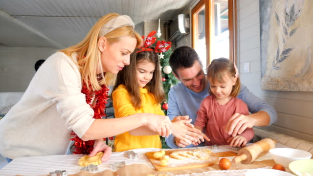 family preparing christmas cookies and having fun - moulding trim stock videos & royalty-free footage