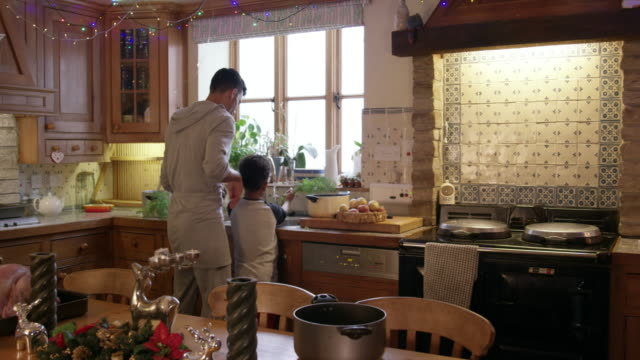 family preparing christmas dinner - pyjamas stock videos & royalty-free footage