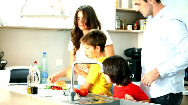 family preparing food in a kitchen. - chores stock videos and b-roll footage