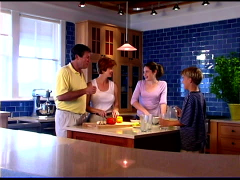 family preparing food in kitchen - see other clips from this shoot 1335 stock videos and b-roll footage