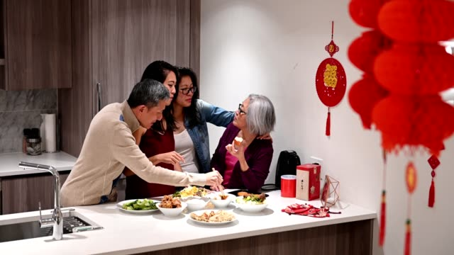 family preparing for chinese new years - chinese ethnicity stock videos & royalty-free footage