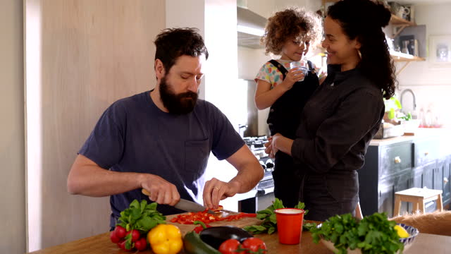 family preparing meal in kitchen - multiracial person stock videos & royalty-free footage