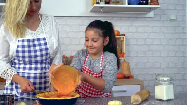 Family Preparing Pumpkin Pie