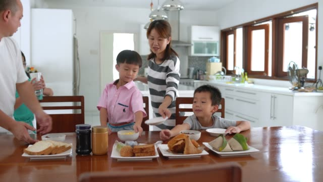 family preparing table for breakfast - family with four children stock videos and b-roll footage