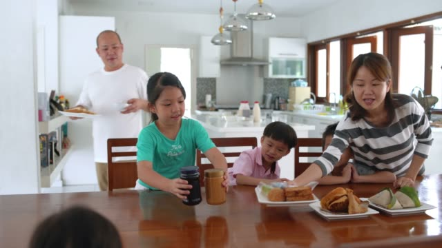 Family preparing table for breakfast