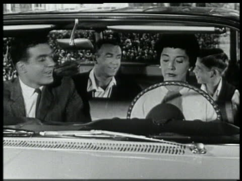 b/w 1959 family preparing to test drive a new chevrolet / woman sits at drivers side - 試運転点の映像素材/bロール