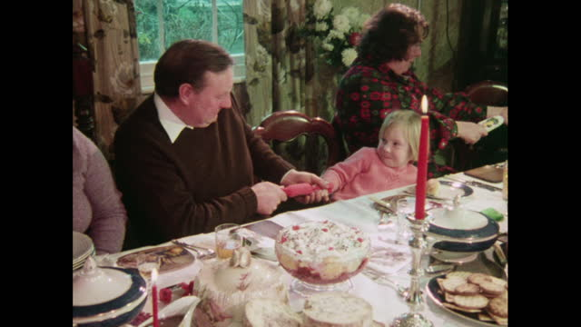 a family pulls christmas crackers - cracker stock videos & royalty-free footage