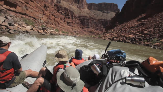 ws pov family rafting on colorado river in grand canyon / grand canyon village, arizona, usa - grand canyon national park stock videos & royalty-free footage