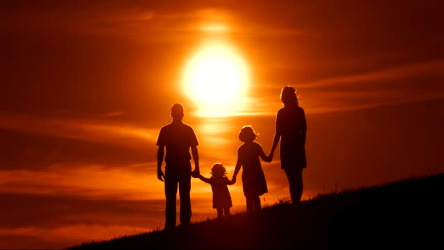 HD SLOW MOTION: Family Raising Hands At Sunset