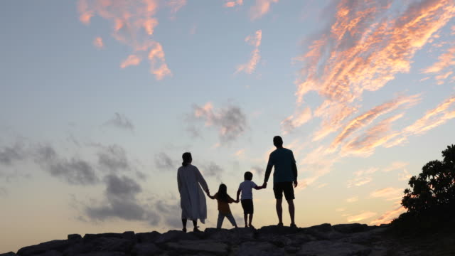 family relaxed in the beach at dusk - anticipation stock videos & royalty-free footage