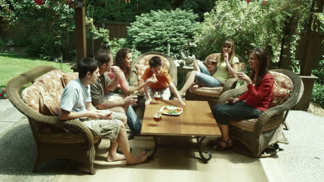 WS Family relaxing and eating in patio / Renton, Washington, USA