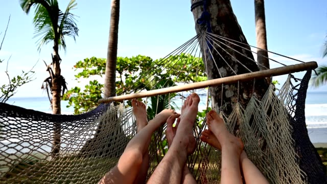 family relaxing in a hammock - sitting stock videos & royalty-free footage