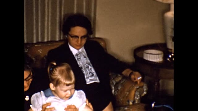 1957 family relaxing on couch - little girl smoking cigarette stock videos and b-roll footage