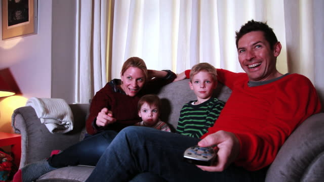 family relaxing on sofa together - greater london stock videos & royalty-free footage