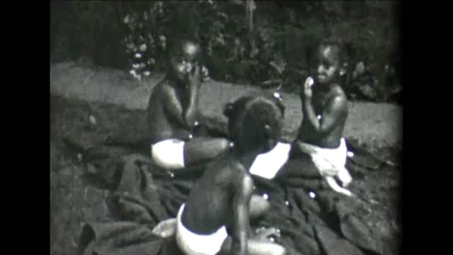 1955 family relaxing outdoors - produced segment stock videos & royalty-free footage