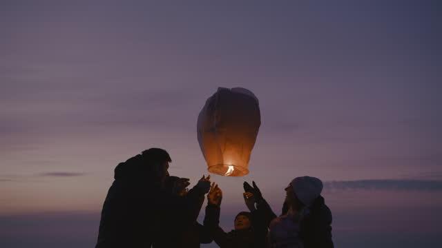 family releasing burning sky lantern - releasing stock videos & royalty-free footage