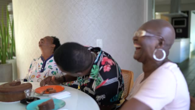 family reunited in the kitchen eating cake during coffee break - candid stock videos & royalty-free footage