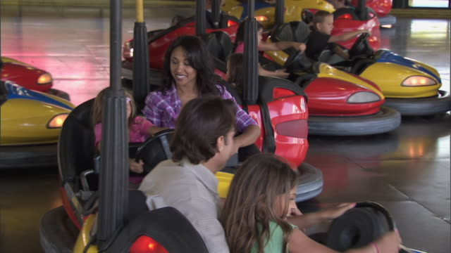 family rides bumper cars at knott's berry farm theme park - bumper car stock videos & royalty-free footage