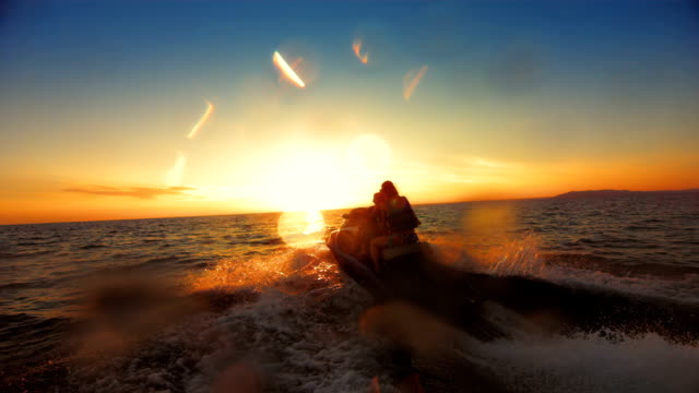 slo mo family riding a jet boat at sunset - jet boating stock videos & royalty-free footage