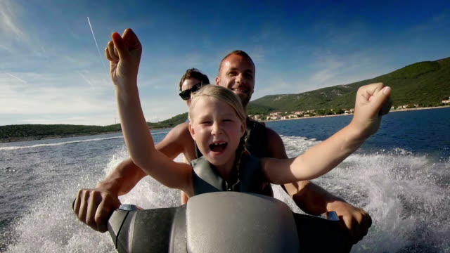 pov family riding a jet boat - recreational pursuit stock videos & royalty-free footage