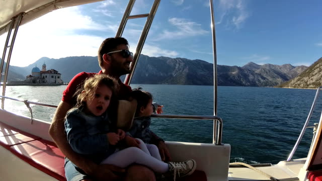 hd family riding in the motor boat - perast stock videos and b-roll footage