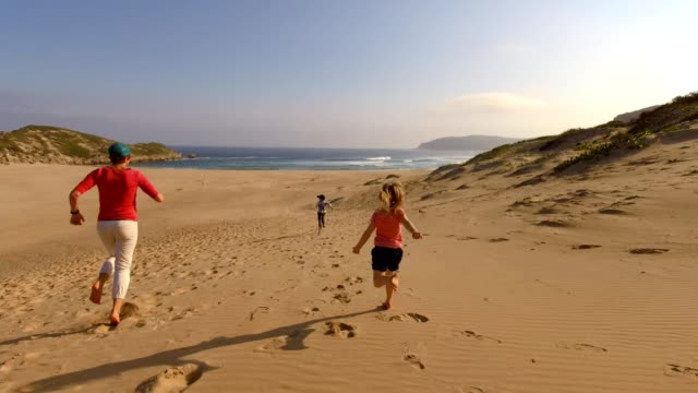 family running fast downhill on sand at beach - sand dune stock videos & royalty-free footage