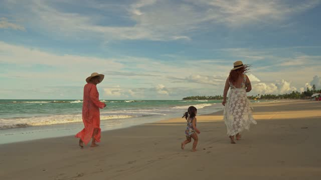 family running on the beach - tropical climate stock videos & royalty-free footage