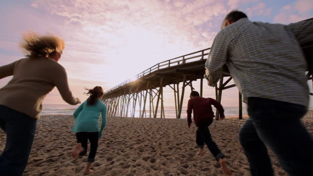 family running to shore together - wilmington north carolina stock videos & royalty-free footage