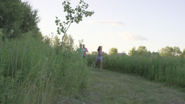 family running together outdoors - traditionally canadian stock videos and b-roll footage