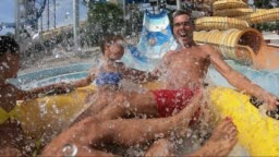 Family Screaming and Laughing on a Waterslide
