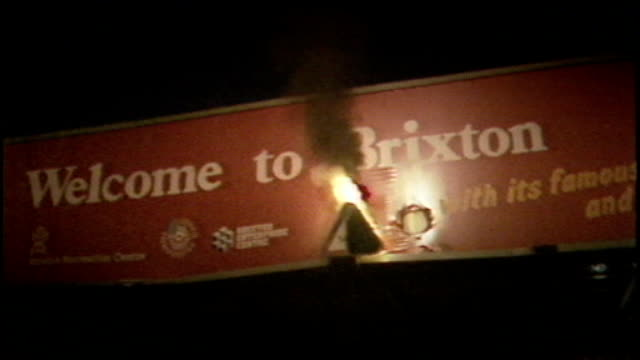 family seek apology from met police over cherry groce shooting in brixton s10021001 / tx 2891985 various shots of rioting and building on fire... - ブリックストン点の映像素材/bロール