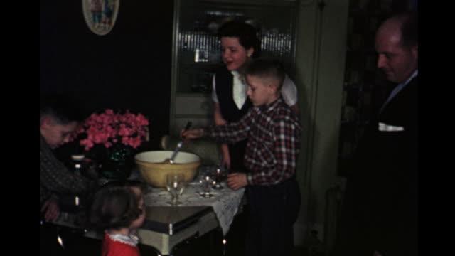 1957 home movie family serving themselves from punch bowl / toronto, canada - 1957 bildbanksvideor och videomaterial från bakom kulisserna