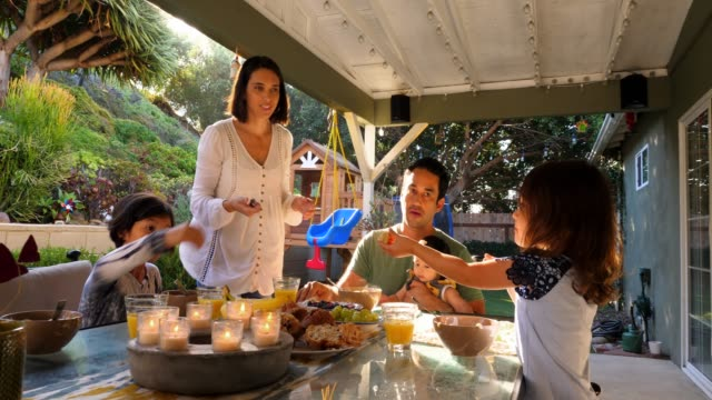ms family sharing breakfast together at table in backyard - healthy eating stock videos & royalty-free footage