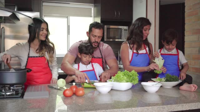 family sharing while cooking - latin american culture stock videos & royalty-free footage