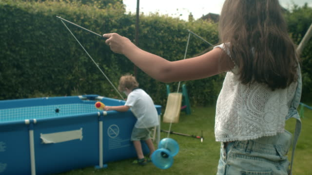 family shoot - squirt gun stock videos and b-roll footage