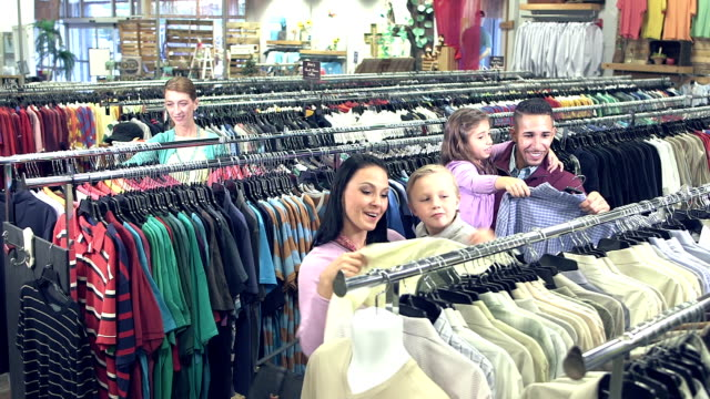family shopping in clothing store with children - clothing store stock videos & royalty-free footage
