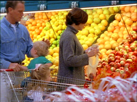 Family shopping in produce section of supermarket