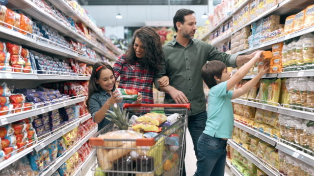 family shopping in supermarket - family with two children stock videos & royalty-free footage