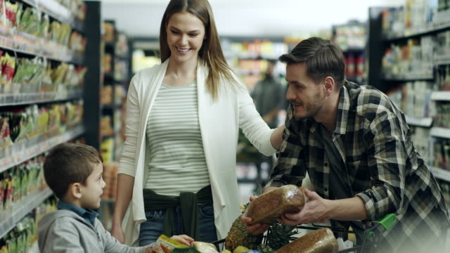 family shopping in supermarket - young family stock videos & royalty-free footage